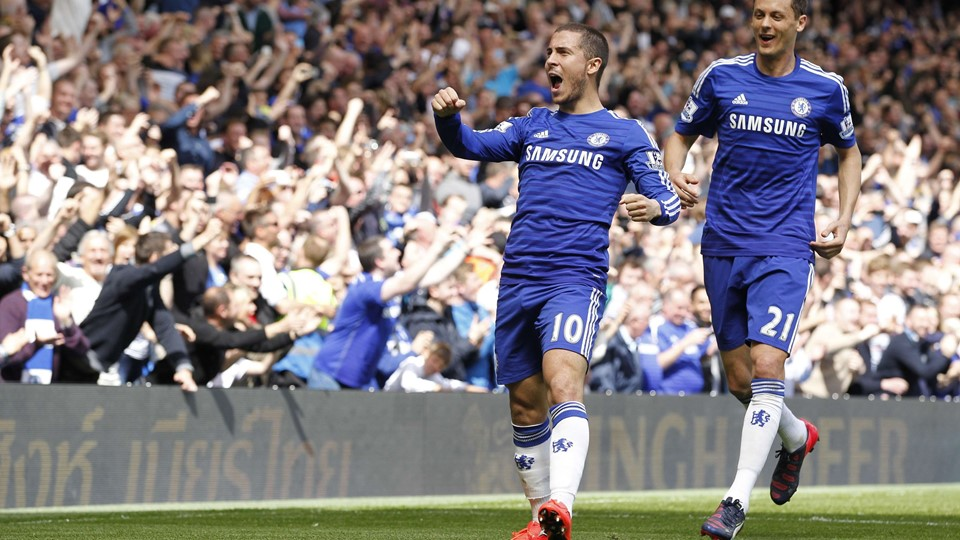 """Chelsea's Belgian midfielder Eden Hazard (L) celebrates with Chelsea's Serbian midfielder Nemanja Matic after scoring during the English Premier League football match between Chelsea and Crystal Palace at Stamford Bridge in London on May 3, 2015. AFP PHOTO / IAN KINGTON RESTRICTED TO EDITORIAL USE.No use with unauthorized audio, video, data, fixture lists, club/league logos or """"live"""" services. Online in-match use limited to 45 images, no video emulation.No use in betting, games or single club/league/player publications. """""""