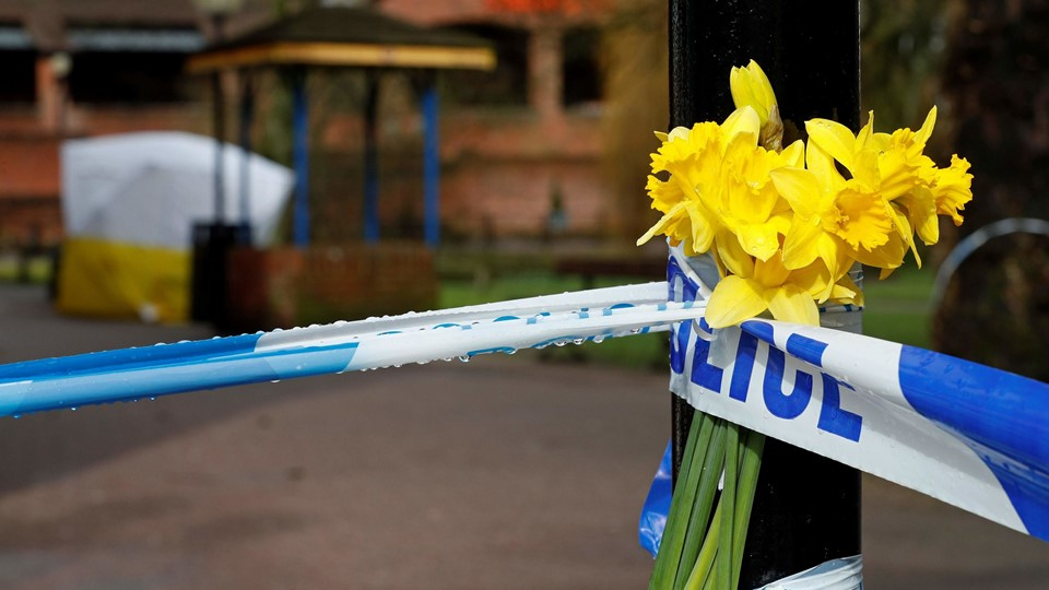 Flowers are pictured at a police cordon near a bench covered in a protective tent at The Maltings shopping centre in Salisbury, southern England, on March 12, 2018, where a man and woman were found critically ill on March 4, after being apparently poisoned with what was later identified as a nerve agent sparking a major incident. British Prime Minister Theresa May will chair a meeting of her national security team Monday after weekend confirmation that traces of a nerve agent used in the attempted murder of former Russian spy Sergei Skripal, and his daughter Yulia, were found in a pub and a restaurant they visited. / AFP PHOTO / Adrian DENNIS