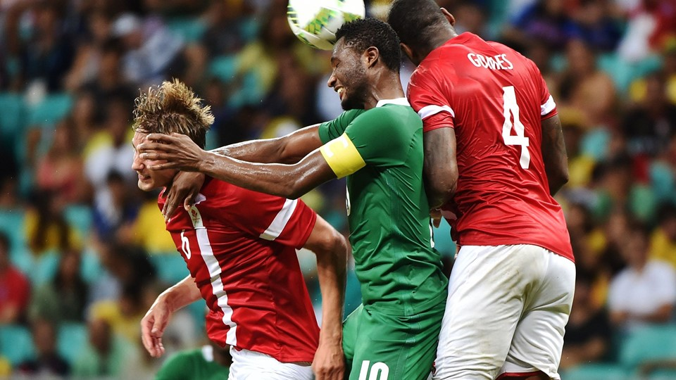 John Obi Mikel (C) of Nigeria heads for the ball with Andreas Maxso (L) and Edigerson Gomes (R) of Denmark during the Rio 2016 Olympic Games men's quarter-final football match Nigeria vs Denmark, at the Arena Fonte Nova Stadium in Salvador, Brazil on August 13, 2016. / AFP PHOTO / NELSON ALMEIDA