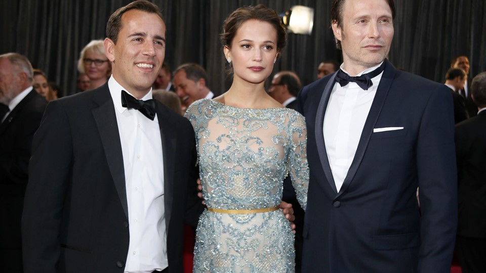 Director Nikolaj Arcel and actors Alicia Vikander and Mads Mikkelsen of Foto: Reuters/Lucy Nicholson