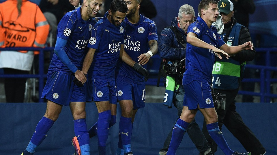 Leicester City's Algerian midfielder Riyad Mahrez (2L) celebrates with Leicester City's Algerian striker Islam Slimani (L) after scoring his team's first goal during the UEFA Champions League group G football match between Leicester City and FC Copenhagen at the King Power Stadium in Leicester, central England on October 18, 2016. / AFP PHOTO / OLI SCARFF