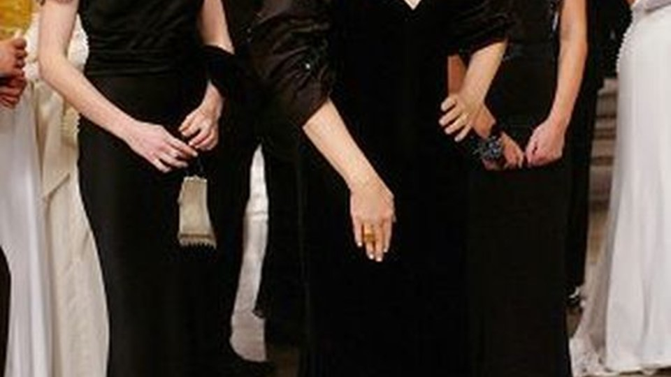 At an important party, fashion magazine editor Miranda Priestly (Meryl Streep) is flanked by her two assistants, Andy (Anne Hathaway, left) and Emily (Emily Blunt).   PHOTOGRAPHS TO BE USED SOLELY FOR ADVERTISING, PROMOTION, PUBLICITY OR REVIEWS OF THIS SPECIFIC MOTION PICTURE AND TO REMAIN THE PROPERTY OF THE STUDIO. NOT FOR SALE OR REDISTRIBUTION.