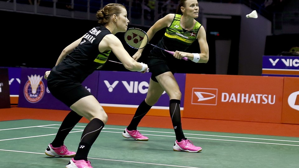 Denmark's Kamilla Rytter Juhl, right, and Christinna Pedersen prepare to return a shot to China's Chen Qingchen and Jia Yifan during their women's doubles final match at the Malaysia Masters badminton tournament in Kuala Lumpur, Malaysia, Sunday, Jan. 21, 2018. (AP Photo/Sadiq Asyraf)