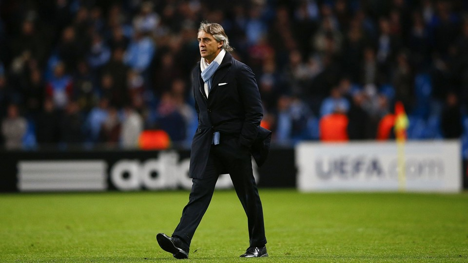 Manchester City's coach Roberto Mancini walks on the pitch to speak with officials after their Champions League Group D soccer match against Ajax Amsterdam at The Etihad Stadium in Manchester, northern England, November 6, 2012. REUTERS/Darren Staples (BRITAIN - Tags: SPORT SOCCER)